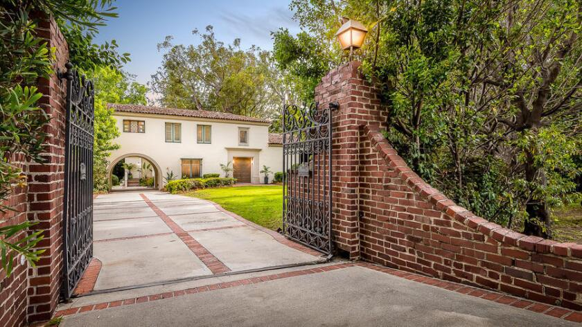 The 1920s Spanish Revival-style home sits on about an acre in the Brentwood Park are