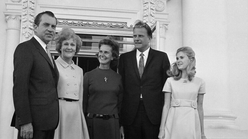 President Nixon, left, and Pat Nixon, second from left, stand at the White House North Portico in 19