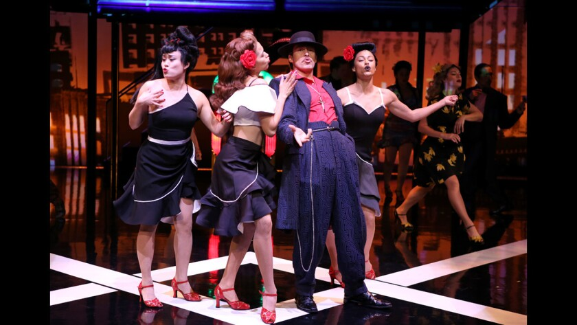 """Demian Bichir, center, as El Pachuco in """"Zoot Suit"""" at the Mark Taper Forum in Los Angeles."""