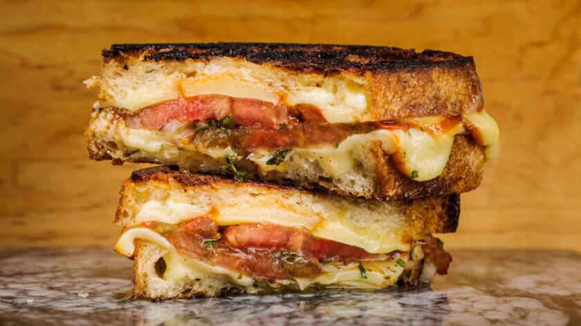 Grilled cheese with marinated tomatoes.