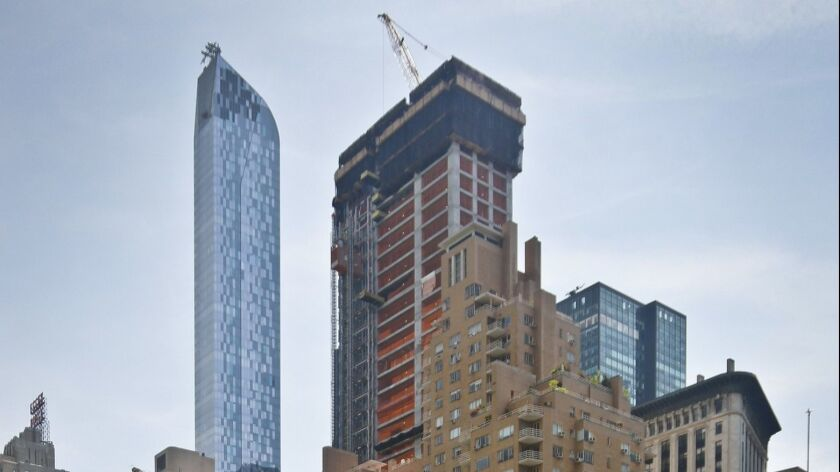 "A luxury 90-floor apartment skyscraper called ""One57,"" left, rises above all other buildings overloo"