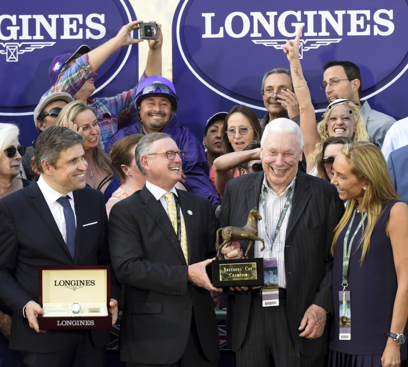 B. Wayne Hughes, second from right, celebrated after his horse won at Santa Anita in 2016.