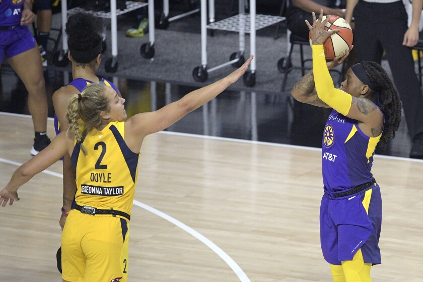 Sparks guard Riquna Williams goes up for a shot in front of Indiana Fever guard Kathleen Doyle.