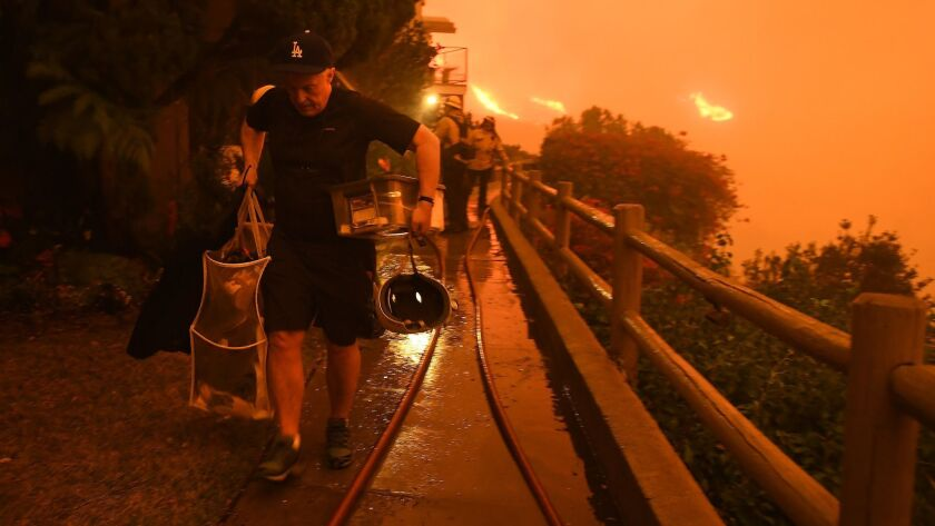 MALIBU, CALIFORNIA NOVEMBER 9, 2018-Resident Brett Hammond evacuates in Malibu as the Woolsey Fire a