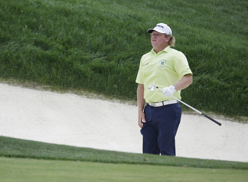 William McGirt jumps before hitting his shot on the 17th hole during the third round of the Memorial golf tournament, Saturday, June 4, 2016, in Dublin, Ohio. (AP Photo/Darron Cummings)