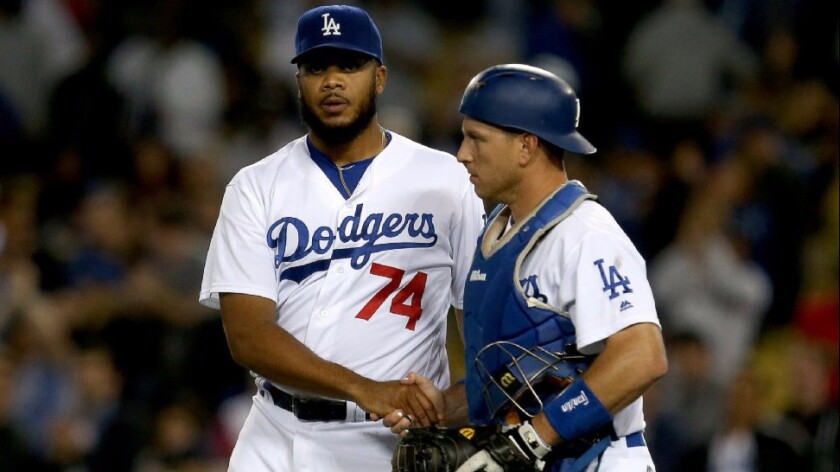 Dodgers catcher A.J. Ellis congratulates closer Kenley Jansen (74) after a 5-1 victory over the Angels on May 17.