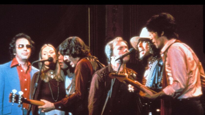 """Van Morrison is shown performing at the legendary """"The Last Waltz"""" concert in 1976. Shown from left are Neil Diamond, Joni Mitchell, Neil Young, Rick Danko, Morrison, Bob Dylan and Robbie Robertson."""