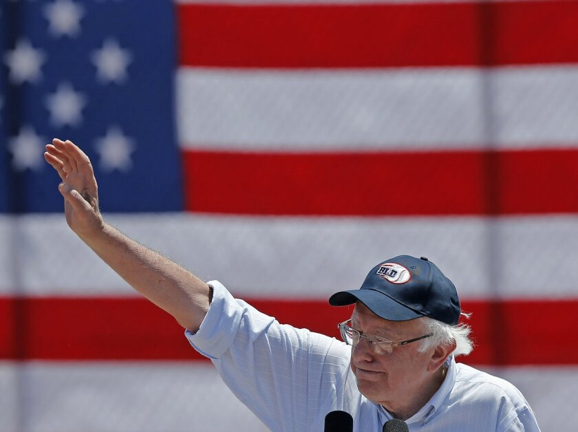 Democratic presidential candidate Sen. Bernie Sanders, I-Vt., waves during a campaign rally in Cathedral City, Calif., Wednesday, May 25, 2016. (AP Photo/Damian Dovarganes)