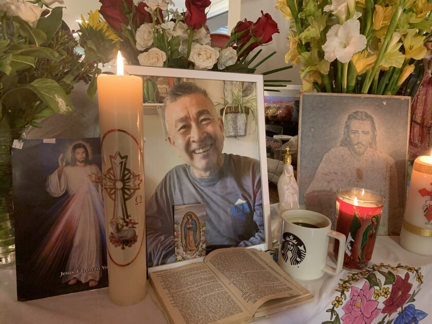 A family altar to Claudio Arturo Diaz, who died in San Rafael on April 4 after a two-month battle with COVID-19.