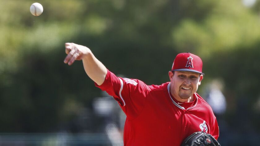 Angeles starting pitcher Trevor Cahill pitches in the first inning of an exhibition game against the Chicago White Sox on March 4.