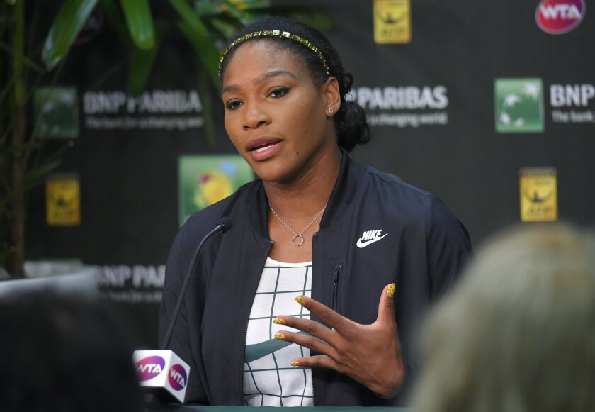 Serena Williams takes part in an interview at the BNP Paribas Open tennis tournament, Thursday, March 12, 2015, in Indian Wells, Calif. (AP Photo/Mark J. Terrill)