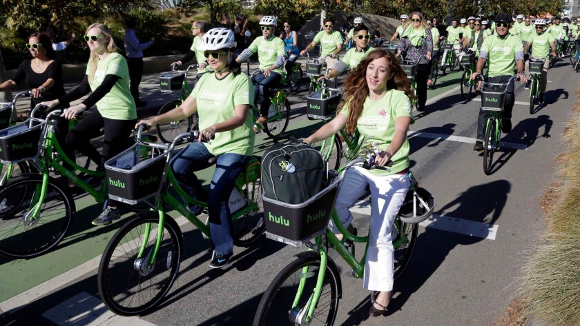Riders try out Santa Monica's new bike-share system, Breeze, on the day of its launch last year.