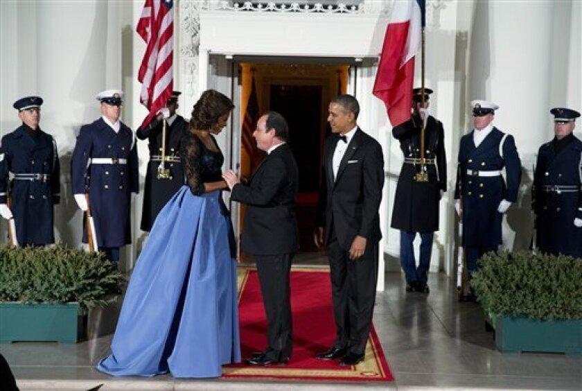 Barack Obama, Francois Hollande, Michelle Obama