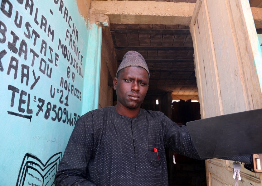 Abdul Aziz Bah, 34, a marabout based in the Keur Massar suburb of Dakar who is responsible for 100 c