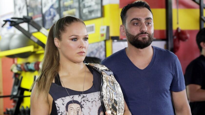 UFC champion Ronda Rousey and her coach, Edmond Tarverdyan.
