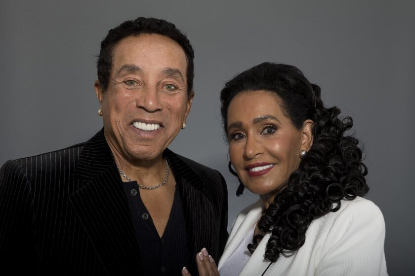 """In this May 27, 2016 photo, music legend Smokey Robinson and his wife, Frances Gladney, pose in Los Angeles to promote their new skincare lines, """"My Girl"""" for women and """"Get Ready"""" for men. (AP Photo/Jae C. Hong)"""