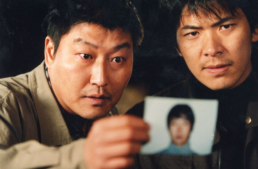 "Song Kang Ho, left, and Kim Sang-kyung in ""Salinui Chueok"" (Memories Of Murder)."