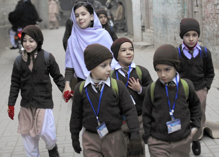 Students return to Pakistani school after Taliban massacre