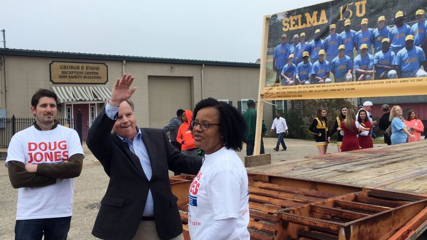 Then-candidate Doug Jones waves during a Christmas parade in Selma, Ala., on Dec. 2.