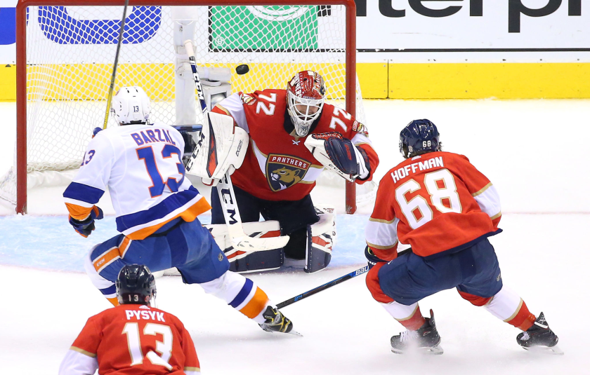 New York Islanders' Mathew Barzal scores as he gets the puck past Florida Panthers goalie Sergei Bobrovsky