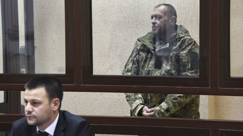 One of the captured Ukrainian sailors speaks in a court room in Simferopol, Crimea, Tuesday, Nov. 27