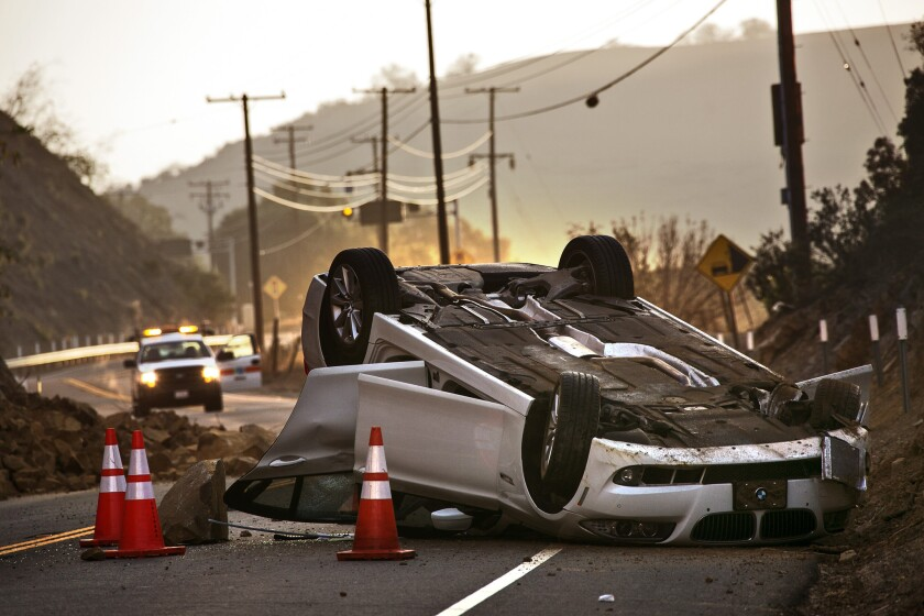 A magnitude 5.1 earthquake in Southern California on March 28 let loose a rock slide that overturned a vehicle in Carbon Canyon. Some lawmakers are seeking federal funds to support an earthquake warning system.