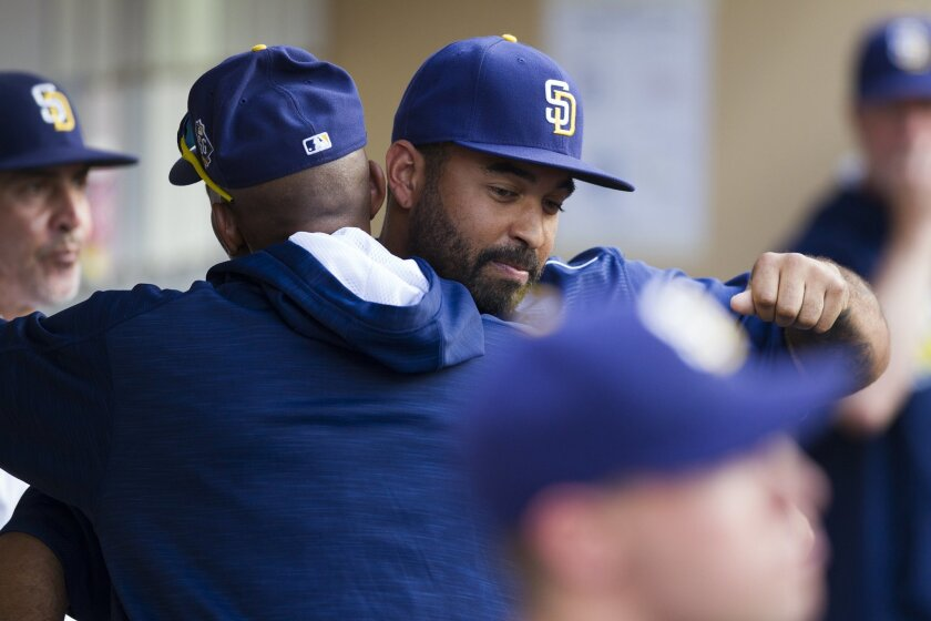 The San Diego Padres take on the Cincinnati Reds at Petco Park on July 30th, 2016. Padres right fielder Matt Kemp was traded before Saturday's game against the Reds. Kemp remained in the dugout for 5 innings before being escorted out, but not before giving some final farewell hugs to his teammates. Matt Kemp hugs infielder Alexei Ramirez before leaving the dugout for the final time. Chadd Cady for the San Diego Union-Tribune