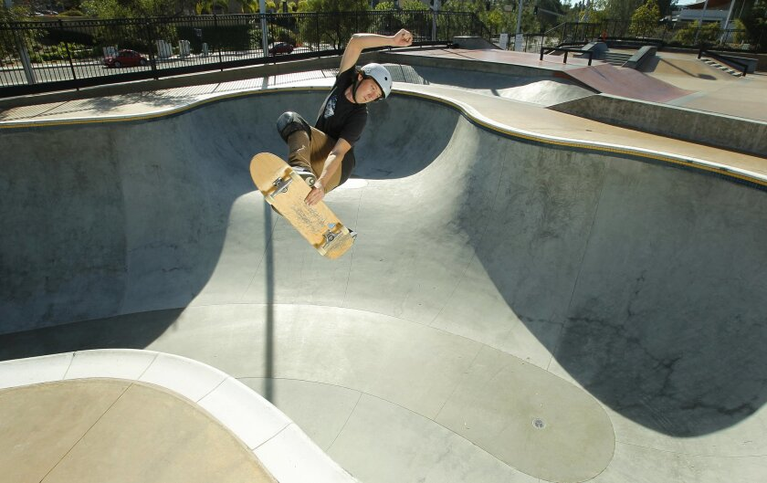 Professional skateboarder Mike Owen does an aerial at the Carmel Valley Skatepark.