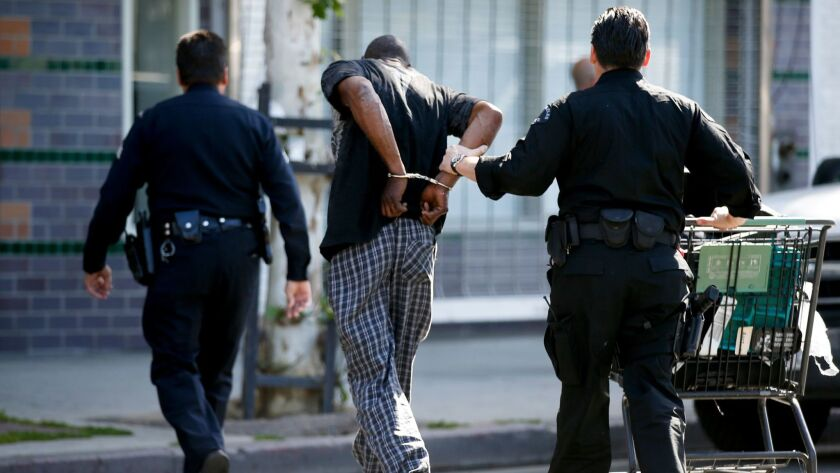 LOS ANGELES, CA., APRIL 20, 2016: LAPD officers arrest a man on skid row for posession of a stolen