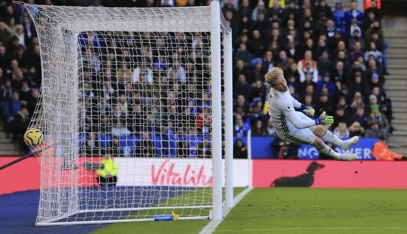 Leicester's goalkeeper Kasper Schmeichel failing to stop the goal scored by Chelsea's Antonio Rudiger during the English Premier League soccer match between Leicester City and Chelsea at the King Power Stadium, in Leicester, England, Saturday, Feb. 1, 2020. (AP Photo/Leila Coker)