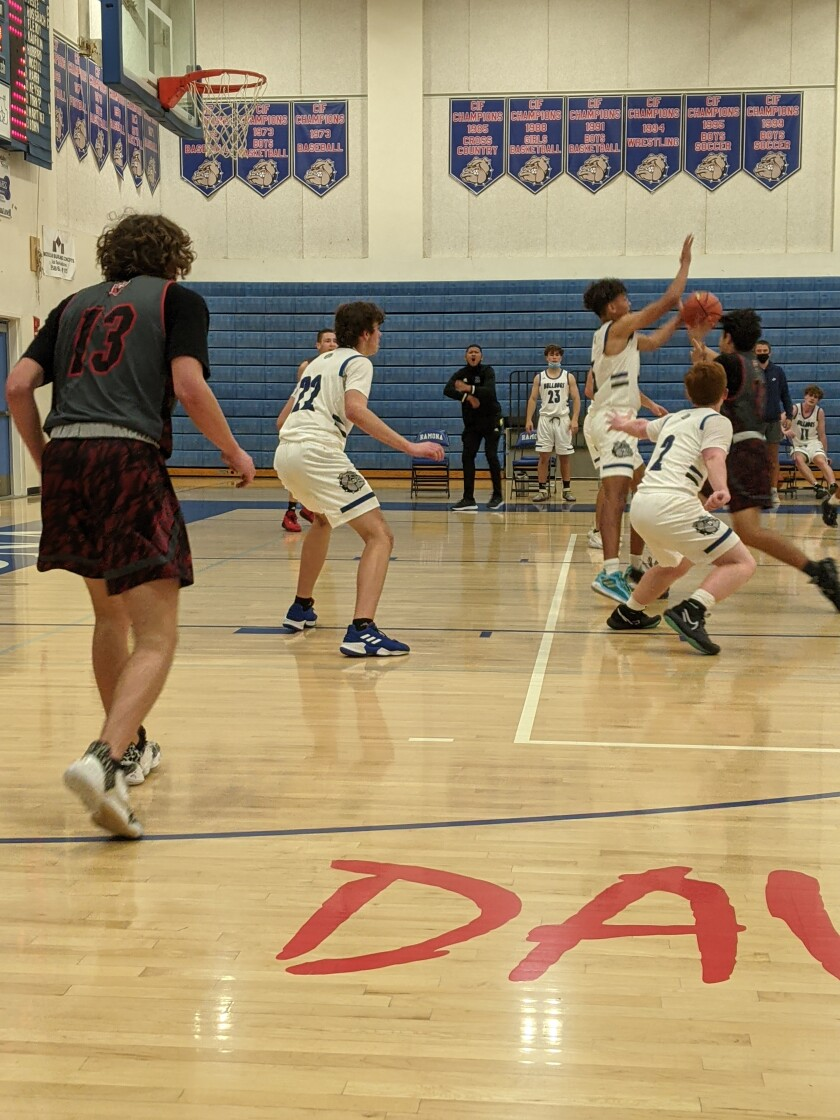 The Ramona Bulldogs boys varsity basketball team lost their first two games in the 2020-21 season to the Vista Panthers.