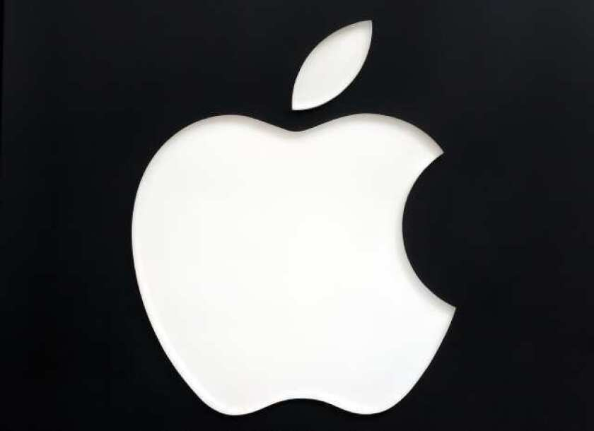 Stock buybacks rose solidly last year, led by Apple Inc.