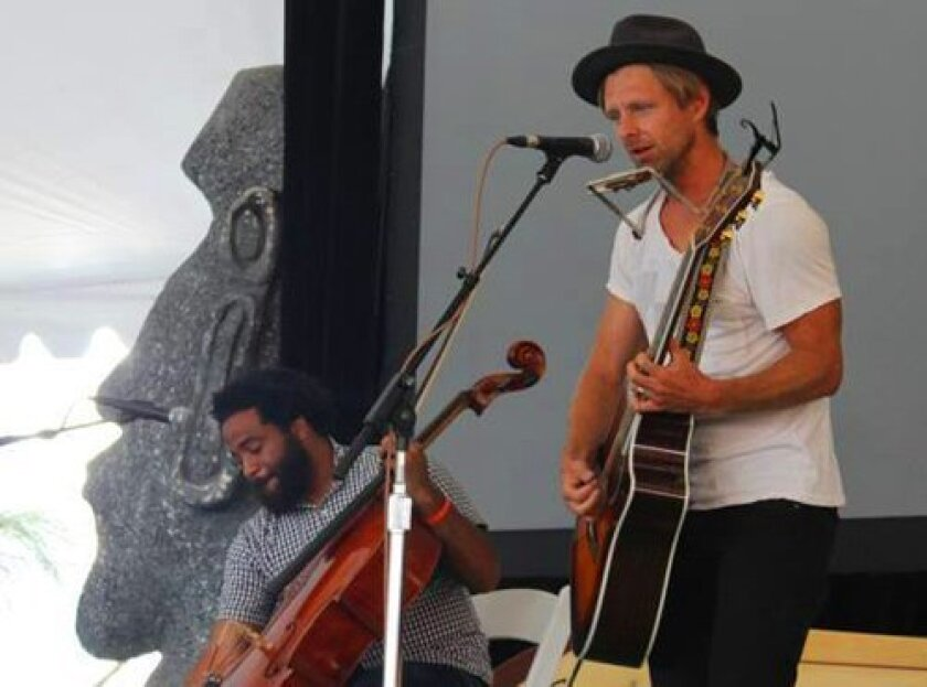 Jon Foreman (right), lead singer from the rock band Switchfoot, performs at the 21st annual Luau and Legends of Surfing Invitational Aug. 17, 2014. (Courtesy Photo)