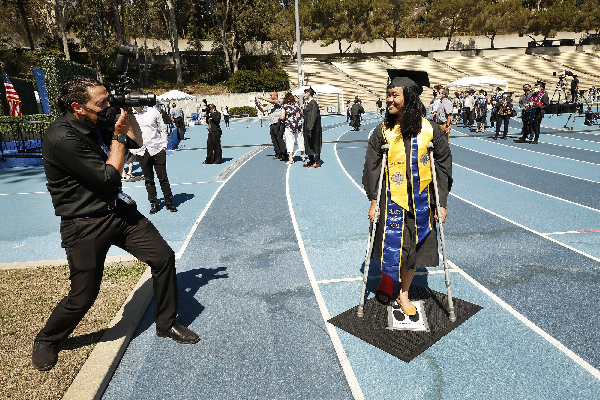 Sophia Bautista, 22, graduating with a degree in Political Science and Labor Studies is on crutches