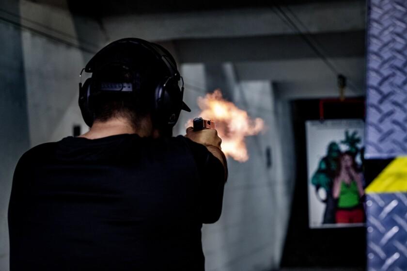 Freddy Torres does target shooting at Riverside Indoor Shooting Range in Riverside.