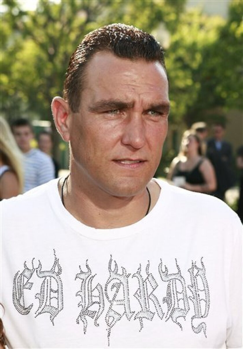"In this Sunday, July 29, 2007, file photo, Vinnie Jones arrives at the premiere of ""Stardust"" in Los Angeles. Jones was arrested after a bar fight, Thursday night, Dec. 4, 2008, in downtown Sioux Falls, S.D. Police said Jones got into a scuffle late Thursday evening at Wiley's Tavern and suffered cuts to the face from a beer glass. He was treated at a hospital, then charged with simple assault and posted bond Friday morning. (AP Photo/Matt Sayles, File)"