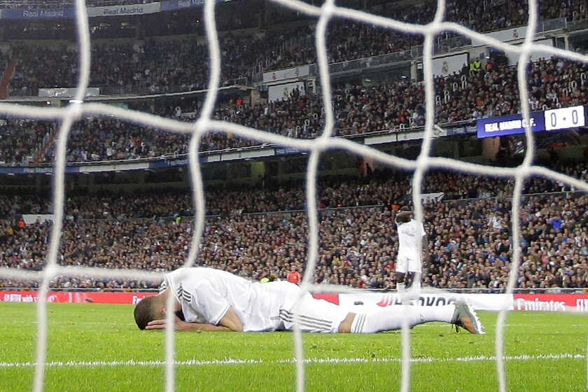 Real Madrid's Karim Benzema, on the ground, reacts after failing to score during a Spanish La Liga soccer match between Real Madrid and Betis at the Santiago Bernabeu stadium in Madrid, Saturday, Nov. 2, 2019. (AP Photo/Manu Fernandez)