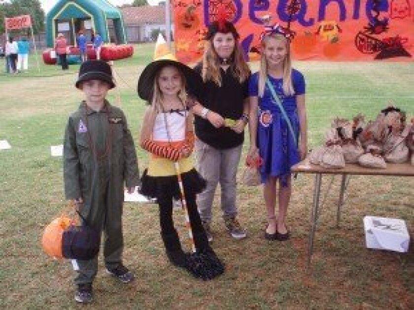 Enjoying a previous Hallween Carnival are: Leo Polidori: Pilot; Ali Polidori: Kandy Korn witch; Abby Freeman: Punker; Jaye Patrick: Winner. Photo/Jeanne Ferris