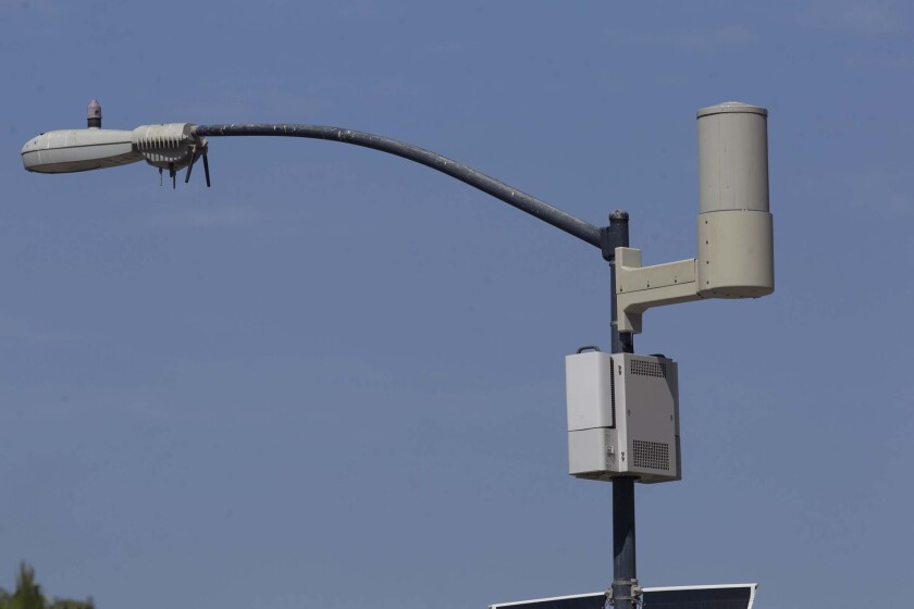 A light pole with attached sensors that make it a smart streetlight