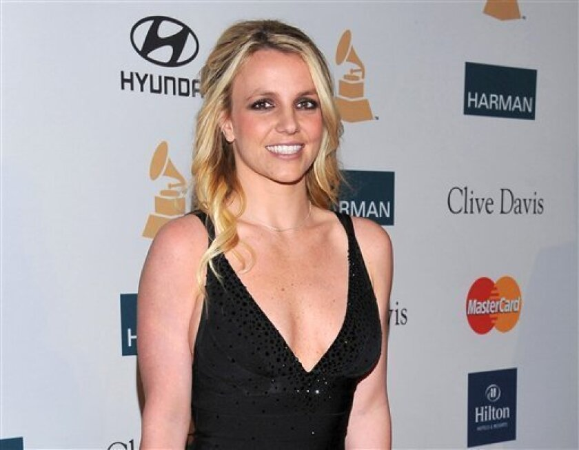 """FILE - In this Feb. 11, 2012 file photo, singer Britney Spears arrives at the Pre-GRAMMY Gala & Salute to Industry Icons with Clive Davis honoring Richard Branson in Beverly Hills, Calif. Spears is a judge on """"The X Factor."""" Fox's """"The X Factor"""" began airing live episodes Wednesday, Oct. 31, 2012, with new co-hosts Khloe Kardashian and Mario Lopez. (AP Photo/Vince Bucci, file)"""