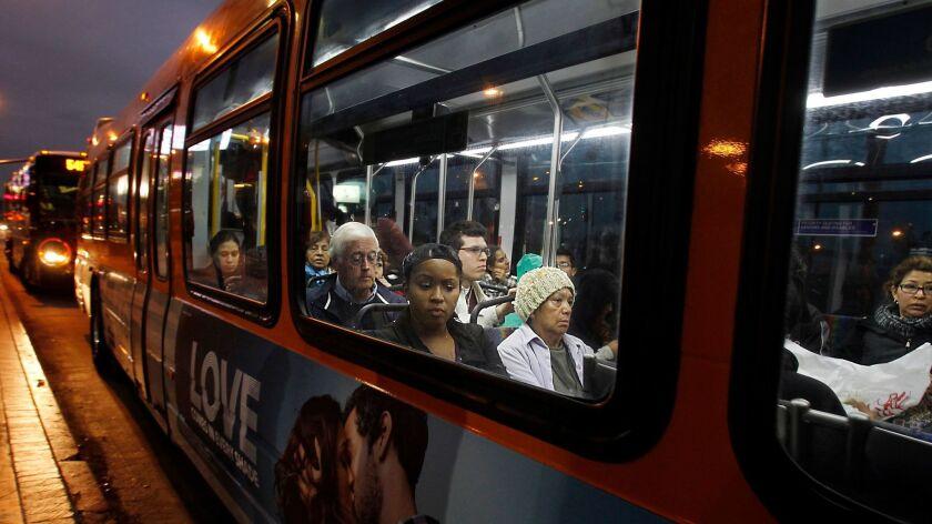 SAN FERNANDO VALLEY, CA. - NOV 30, 2012. MTA buses pick up commuters along Lankershim Boulevard at