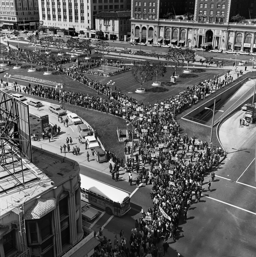 In contrast to today's Pershing Square, the public space on March 13, 1965, during a civil rights protest showed how the square could work without walls.