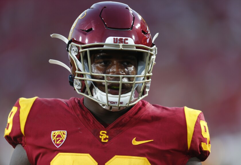 USC defensive lineman Drake Jackson warms up before a game against Stanford on Sept. 7 at the Coliseum.