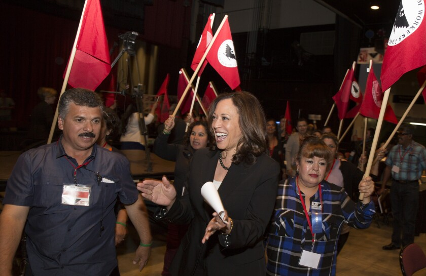 """California Atty. Gen. Kamala Harris, a candidate for U.S. Senate, enters the United Farm Workers convention in Bakersfield chanting """"Sí se puede!"""""""