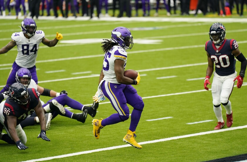Minnesota Vikings running back Alexander Mattison (25) runs for a touchdown against the Houston Texans during the second half of an NFL football game Sunday, Oct. 4, 2020, in Houston. (AP Photo/David J. Phillip)