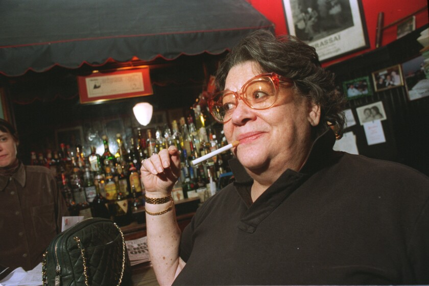 Elaine Kaufman of Elaine's with plastic cigarette.