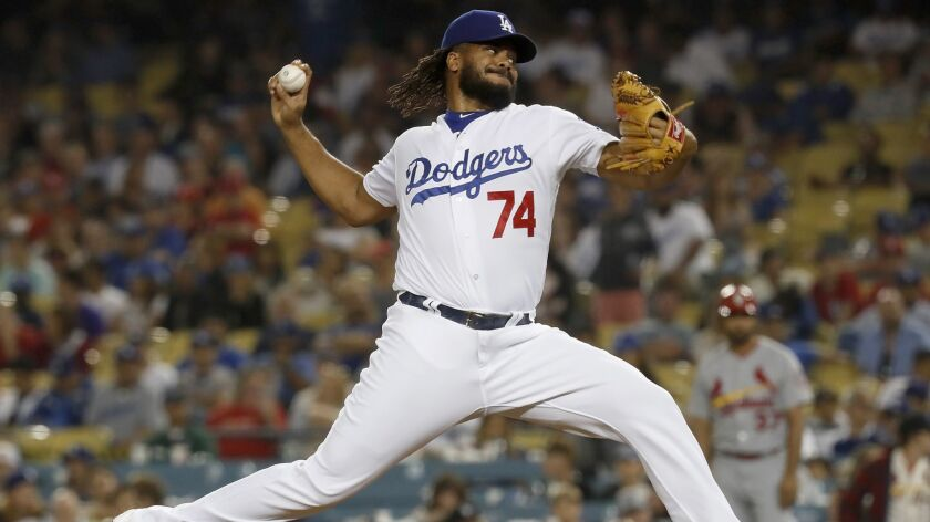 LOS ANGELES, CALIF. - AUG. 22, 2018. Dodgers closwr Kenley Jansen delivers a pitch against the Car
