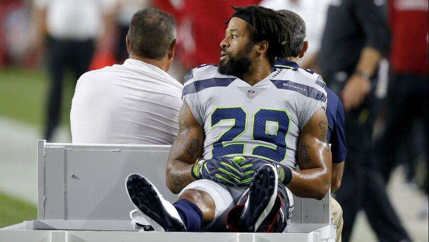 Seattle Seahawks defensive back Earl Thomas (29) leaves the field after breaking his leg against the