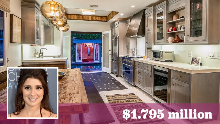 """Actress Shiri Appleby of """"Roswell"""" fame has put her updated English-style cottage in West Hollywood up for sale at $1.795 million."""