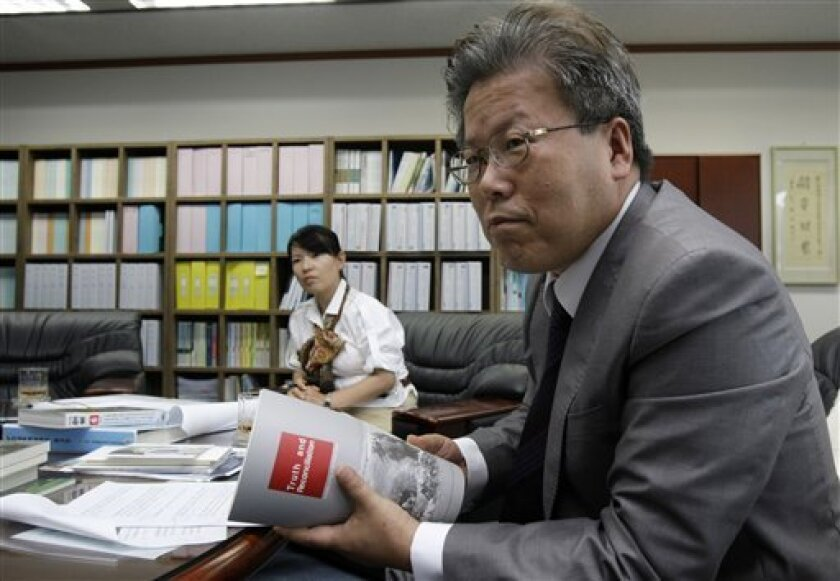 In this June 10, 2010 photo, Lee Young-ho, president of The Truth and Reconciliation Commission, talks during an interview with The Associates Press in Seoul, South Korea. In a political about-face, a South Korean commission investigating the U.S. military's large-scale killing of refugees and othe